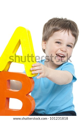 Child with alphabet letters - stock photo