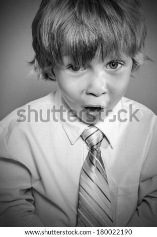 Child with astonished expression - stock photo