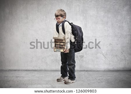 Child with backpack holding some school books