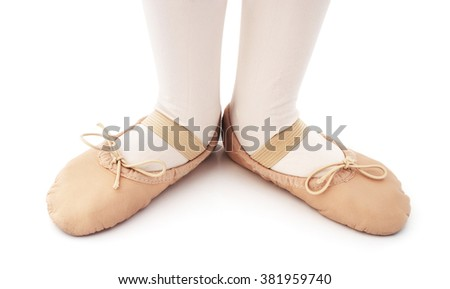 Child with ballet slipper on a isolated white background. - stock photo
