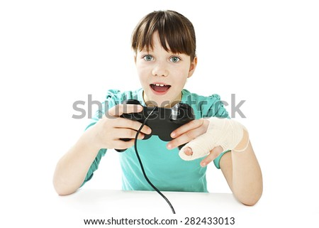 Child with broken arm using video game controller. Isolated on white background