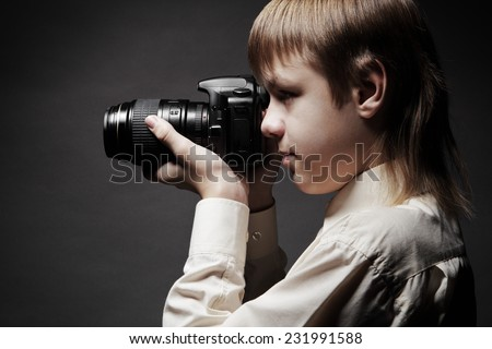 Child with camera - stock photo