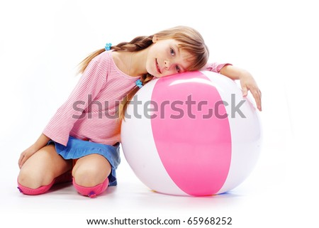 Child with colorful ball on white studio background