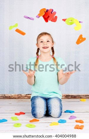Child with colorful  letters - stock photo