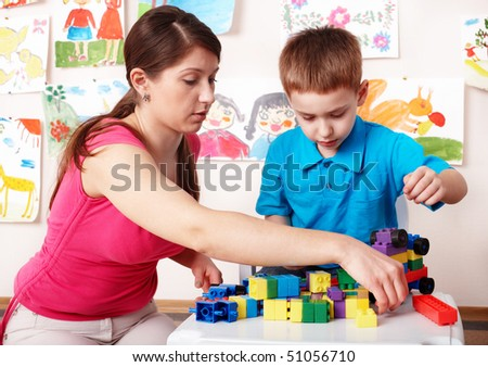 Child with construction  in play room. Preschool. - stock photo