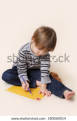 Child with crayon, arts and crafts - stock photo