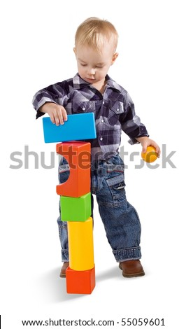 child with cubes on a white background