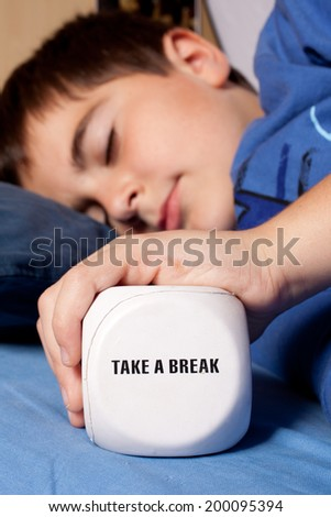 child with dice - take a break - stock photo