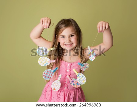 Child with Easter activities and crafts with bunny stickers, Easter Egg shapes in a banner - stock photo