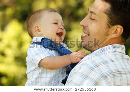 child with father - stock photo