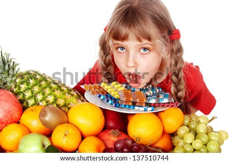 Child with fruit and vitamin pill. Isolated. - stock photo