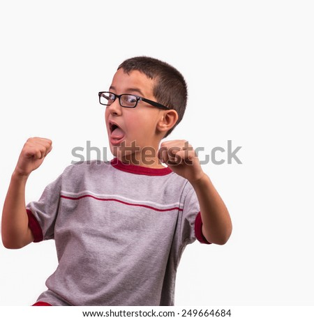 child with glasses jumping for joy - stock photo