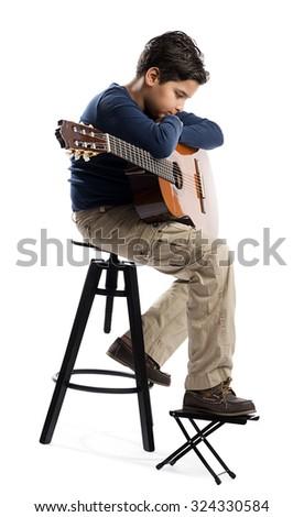 Child with guitar thinking isolated on white background. - stock photo