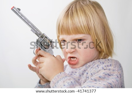 child with gun. boy aiming western style toy weapon - stock photo