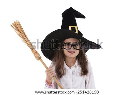 Child with halloween hat and a witch broom - stock photo