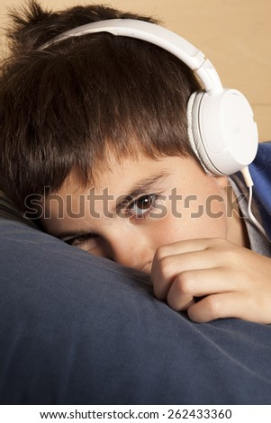 child with headphone - stock photo