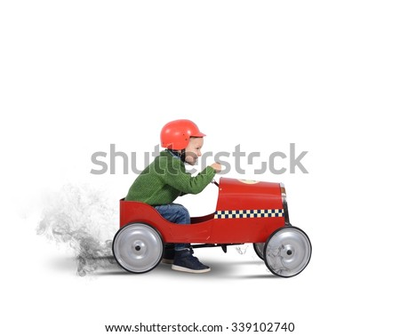 Child with helmet plays with the car - stock photo