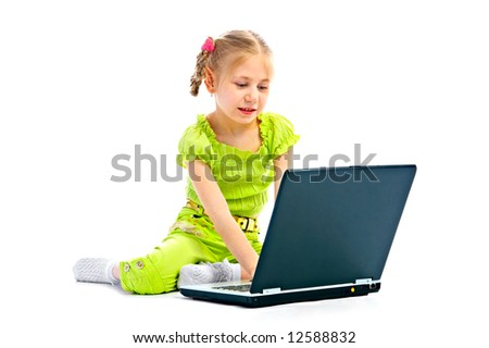 child with laptop isolated on white background - stock photo