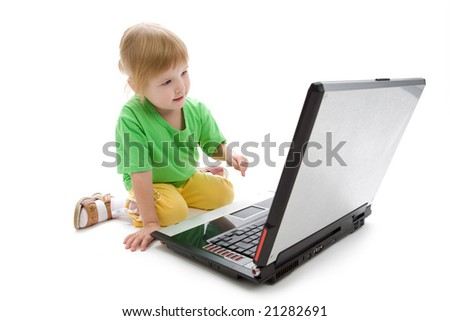child with laptop on white background
