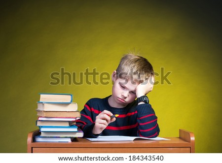 Child with learning difficulties. Doing homework. - stock photo
