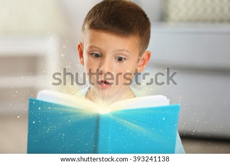 Child with magic book - stock photo