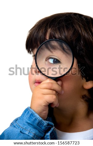 child with magnifying glass isolated on white