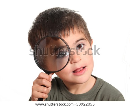 child with magnifying glass isolated on white background - stock photo