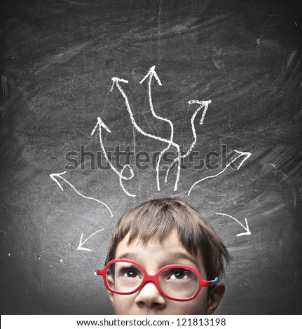 Child with many arrows over his head - stock photo