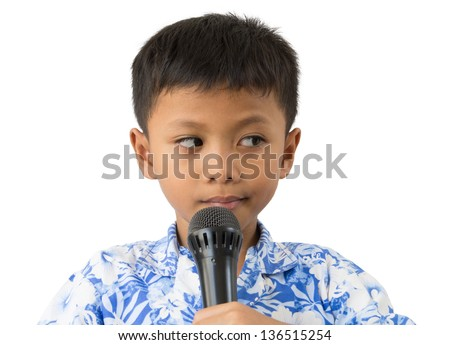 Child with microphone shy to talk - stock photo