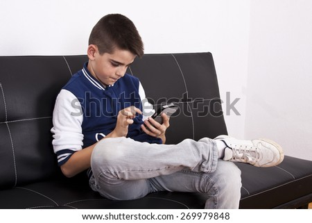 child with mobile phone indoors, technology - stock photo