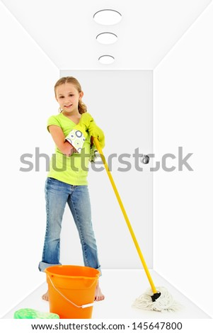 Child with mop bucket sponge in white hallway cleaning. - stock photo