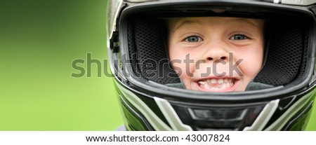 Child with motorbike helmet, safety concept - stock photo