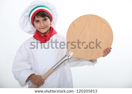 Child with oven shovel