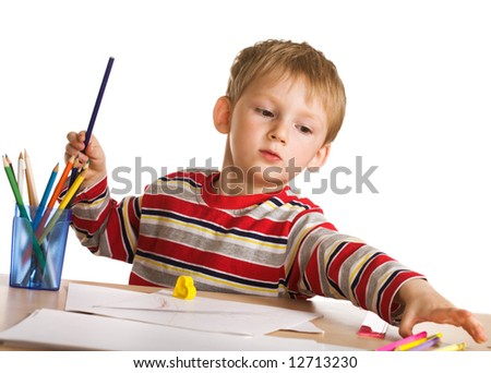 Child with pencils