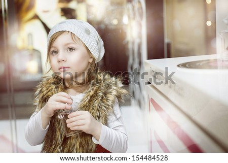 child with perfume in shop, collage - stock photo