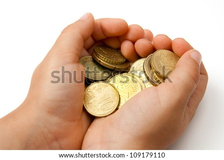 Child with pocket money in her hands - stock photo