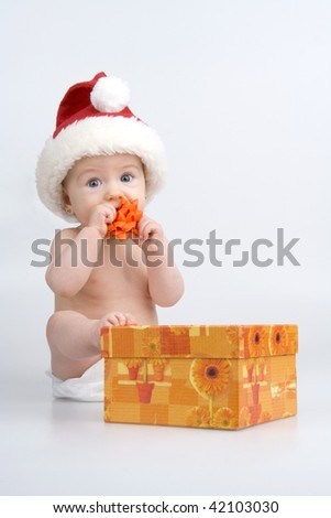 Child with present about Christmas on white background. - stock photo