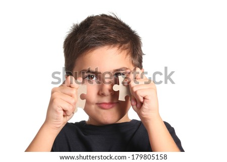 child with puzzle - stock photo