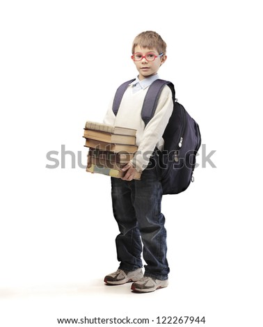 Child with red glasses and backpack holding some school books - stock photo