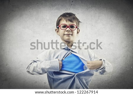 Child with red glasses opening his shirt like a superhero - stock photo