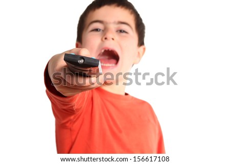 child with remote control isolated on white - focus on hand - stock photo