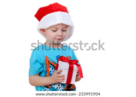 Child with santa hat and gift packs - stock photo