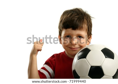 Child with soccer ball shows OK, isolated on white - stock photo