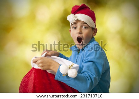 child with surprise christmas gifts - stock photo