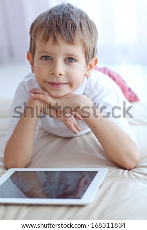 Child with tablet - stock photo