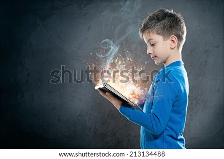 Child with Tablet PC - stock photo