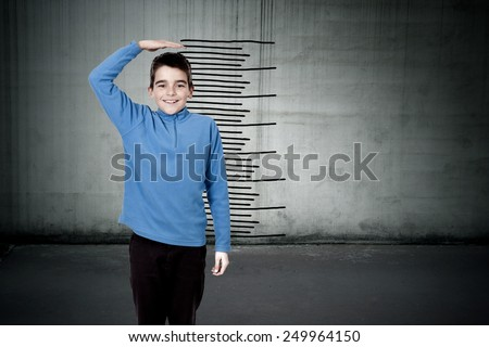 child with the scale of growth - stock photo