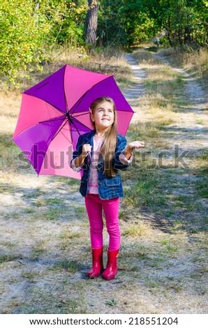 child with umbrella - stock photo