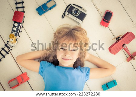 Child with vintage toys. Kid playing at home.  - stock photo