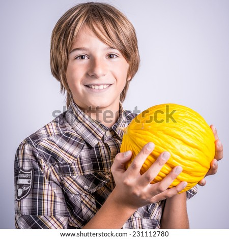 child with yellow melon - stock photo